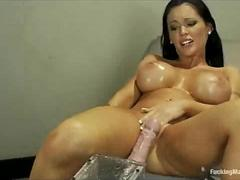 Huge hooters brunette fucks machine and squirts