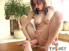 Cutie plays with dildo naked