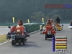 Kinky Jap sluts race around on dildo carts