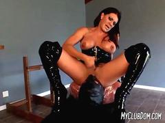 Severe mistress sits on her pvc subs face