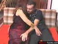 Redhead mature fucking a slick Spanish dude on the couch