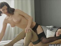 Two babes fuck each other with huge dildo