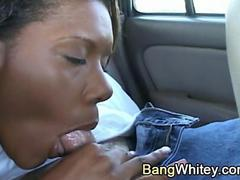 Black girl gives blowjob in car and receives facial