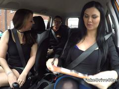 Threesome sex in fake driving school car
