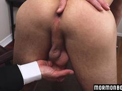 A handsome twink is trying to satisfy his boss in the office and get it on on the table