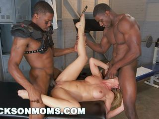 blonde bombshell gets pounded by two beautiful black boys with monster cocks in the gym
