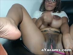 Tattoed busty latina masturbating