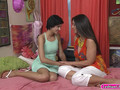 Cadey Mercury and Mindi Mink intimate lesbian action on sofa