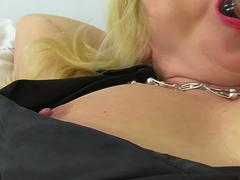 Huge titted blonde mature lady masturbating with a glass toy