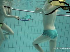 Girls swimming underwater and enjoying eachother