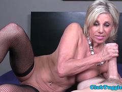Blue eyed mature spoils guy with handjob