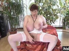 Granny plays with a sex toy