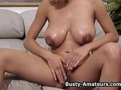 Busty amateur Gia masturbates her pussy on the couch