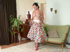 Busty retro brunette Tindra Frost frigs herself deep and hard in nylons garter high heels