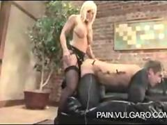 Mature mistress tortures young male slave