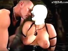Girl In Mask Latex Corset And Boots Getting Her Pussy Fingered Sucking Cock In The Dungeon