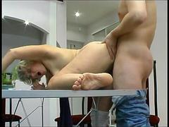 Mature blonde milf seduced a visitor at the table