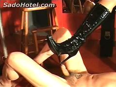 Dirty slave gets his nipples poked by high heel boots