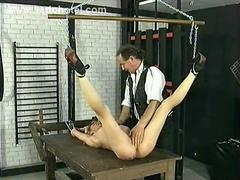 German slave rubbing her pussy and body and got her legs spread by master in a dungeon
