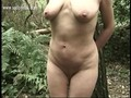 Hot slave tied to a tree with weights on her pierced pussy lips gets clamps on her nice tits while husband is watching