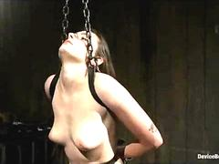 Arms tied back babe gets whipped in dungeon