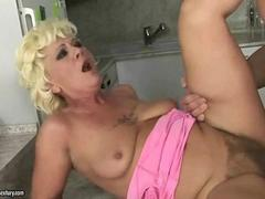 Curly-haired blonde granny gets nailed by a young stud