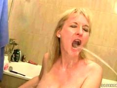 Two guys fucking and pissing on a mature bitch
