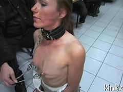 Slave is on her knees gagging deep