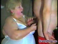 fat granny with a dick in her hand handles it