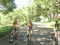 Bike riding chicks duck into the woods for some fun