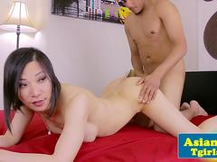 Asian tgirl sucking and fucking black cock