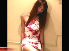 Brunette ladyboy with slim body and very small cock teasing