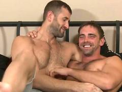 Hairy guys cuddle and give an interview in bed