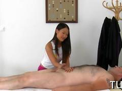Busty Asian massage therapist fucks a fat white client on hidden camera
