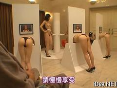 Masked men finger bang Japanese babes through glory holes