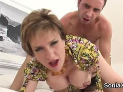 Unfaithful english milf lady sonia showcases her giant melons
