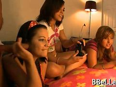 Brunette teen Brandi Belle plays video games while dudes jacks off