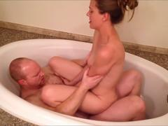 In a bathtub having sex Lesbians