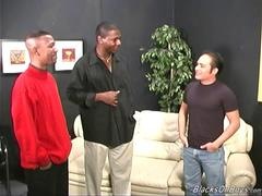 Black men sharing a cheerful latino dude