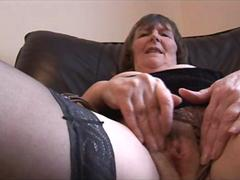 Hairy granny in stockings spreading