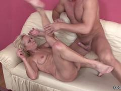 Blonde granny seduced by a handsome stud and fucked hard