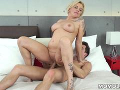 A horny granny seduce a young stud and gets banged in various poses on the bed