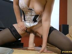 A sexy maid is rubbing her pudenda on a huge dildo on webcam