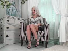 A super hot milf is showing her attributes and masturbate on webcam