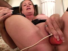 Lovely granny is willing to masturbate with her favorite toy and tease in front of a webcam in closeup