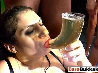 Euro whore enjoy drinking piss from a group of studs