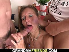 Hairy old mature woman swallows two cocks