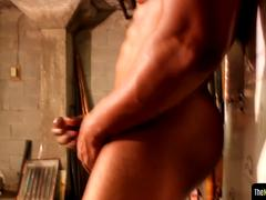Black muscle tugging cock during solo