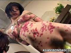 Tied up asian gal drenched in wax clip