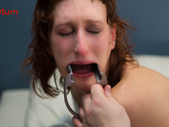 Crying dominatrix gets suspended by her cunt, paddled, and given ass to mouth